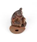 Figura anciano sentado tallada en palo rosa - 17cm